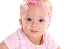 Infant girl. Adorable little infant girl on white background royalty free stock photos