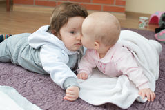 Infant girl and boy on the floor stock photo