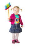 Infant girl child with a broom Stock Photo