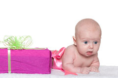 An infant girl and a gift box Stock Photo