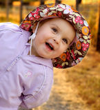 Infant girl goofing around. On a summer evening - blurred background is lit by the setting sun Royalty Free Stock Photo