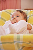 Infant girl in her crib Stock Image