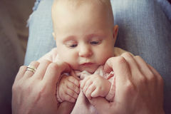 Infant Girl Holding Fathers Hands Royalty Free Stock Photography