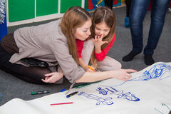 Infant Girl with mom at Drawing lesson Royalty Free Stock Image