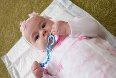 Infant girl in mother club play with toy Stock Photos