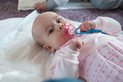 Infant girl in mother club play with toy Stock Photography