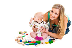 Infant girl playing with bricks Royalty Free Stock Image
