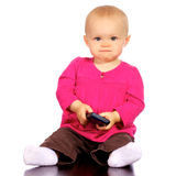 Infant girl playing with a cell phone Royalty Free Stock Images