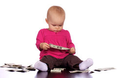 Infant girl playing with money Stock Images