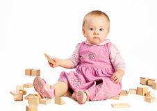Infant girl playing with wooden blocks Stock Photography