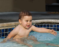 Infant girl in the pool Stock Image