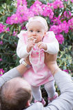 Infant girl in rhododendron Royalty Free Stock Photo