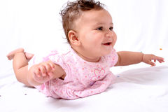 Infant girl rocking on her stomach Stock Photos