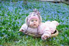 Infant girl snowdrops field Royalty Free Stock Photos