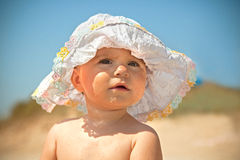 Infant girl in sun with sun hat. Fanny infant girl in sun with sun hat Royalty Free Stock Photography