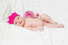 Infant girl is wearing pink crown Stock Photos