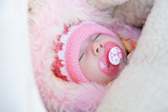 Infant girl sleep. Infant girl on a winter walk in a carriage Royalty Free Stock Photo