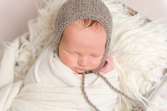 Infant with gray hat on napping, closeup Royalty Free Stock Photo