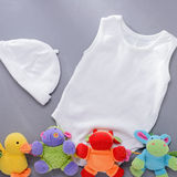 Infant hat and shirt with four plush toys Royalty Free Stock Photo