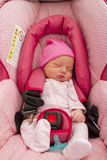 Infant in her Car Seat. Two days old cute Infant in her Car Seat with complimanting colors Royalty Free Stock Photo