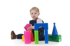 Infant with his toy Stock Photo
