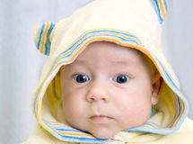 Infant in hood Royalty Free Stock Photo