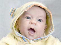 Infant in hood Royalty Free Stock Images