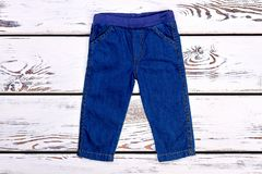 Infant kids denim trousers on sale. Stock Photography
