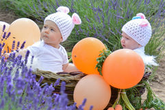 Infant kids in rabbit suits Stock Images
