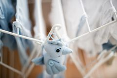 Soft toy blue bird near infant baby laundry drying Royalty Free Stock Photo