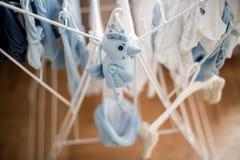 soft toy blue bird near infant baby laundry drying Stock Photo
