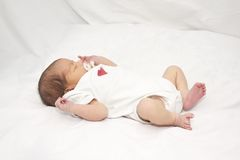 Infant laying on her back Stock Image