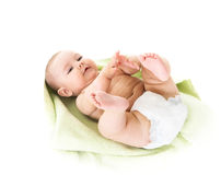 Infant laying on a towel Stock Photo