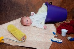 Infant laying on creative background with repairing tools stock photos