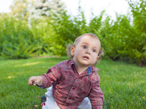 An infant learns to walk. Royalty Free Stock Photo
