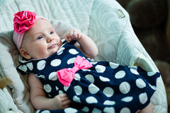 Infant lies in the armchair for toddlers. Stock Photography