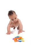 Infant little boy crawling towards the viewer Stock Image