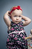 Infant little girl with red bow Stock Photography