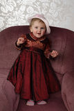 Infant in in long red dress Stock Images