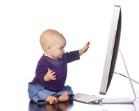 Infant looking at the computer Royalty Free Stock Image