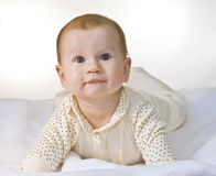 Infant lying. Six months old infant lying on white towel Royalty Free Stock Image