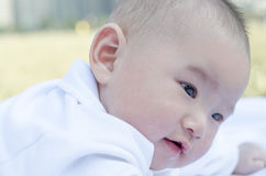 Infant lying on the grass Royalty Free Stock Images