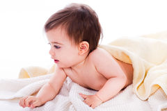 Infant lying under the yellow towel Royalty Free Stock Photos