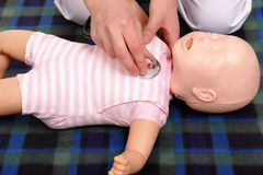 Infant medical examination demonstration Stock Images