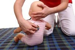 Infant medical examination demonstration Royalty Free Stock Images