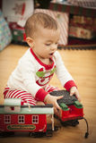 Infant Mixed Race Baby Enjoying Christmas Morning Near The Tree royalty free stock photography