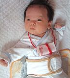 Infant and Money Royalty Free Stock Photography
