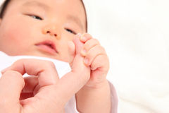 Infant the mother holds the hand Stock Photo