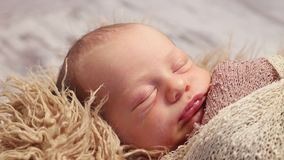 Infant moving his lips, wrinking, closeup stock video footage