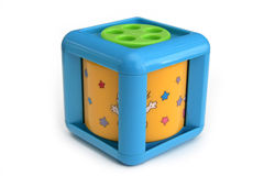 Infant musical cube. A hollow cube with turning musical cylinder within, for young children Stock Image